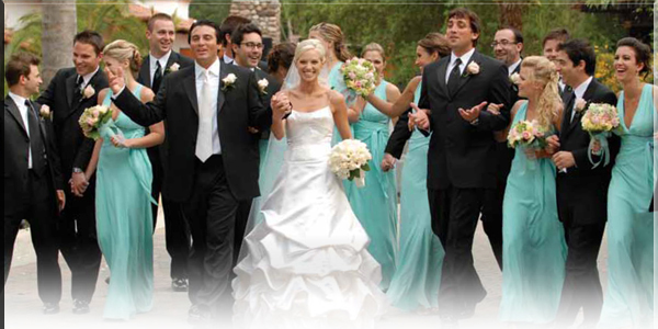 The Best Wedding Reception Ever! Wedding Party Cover Photo of the Bride & Groom walking and talking with their Groomsmen in their tuxes and their Bridesmaids in their Tiffany Blue dresses at Rancho Capistrano in Silverado Canyon, California. Photo Credit: Jim Kennedy Photographers